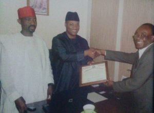 Amb. Aminu Majidadi being Presented with an Ambassador for Peace