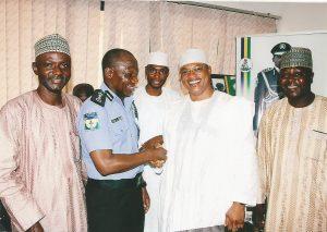 Handshake with the IG of Police, Ibrahim Idris